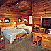 Buckrail Lodge - lodgepole cabin-style rooms - Spacious log rooms & Western decor just minutes from Town Square. Family-owned, flower-laden gardens, hot tub, smoke free environment & quiet solitude. NEW VIDEO.